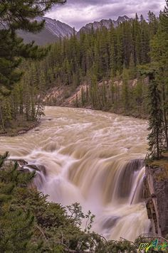 Sunwapta Falls is a waterfall of the Sunwapta River located in Jasper National Park, Canada.  It is accessible via a short drive off the Icefields Parkway that connects Jasper and Banff National Parks. The falls have a drop of about 18.5 metres. Sunwapta is a native word that means turbulent water. It is most spectacular in the late spring when the spring melt is at its peak. Courtesy www.pxArt.ca.
