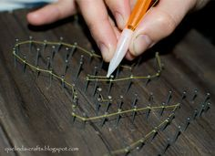 "SUPER idea for string art...pull the ""guts"" out of a mechanical pencil, chip a little hole in the side to feed the string through...makes going around the nails so much easier!"