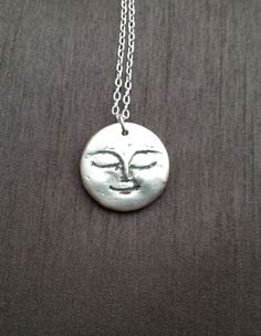 Full Moon Pendant Necklace by BitsofSilver on Etsy ; Handcrafted and etched in fine silver clay(.999%pure silver) and hangs on an 18 in., sterling silver chain. ($50)
