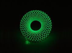"Ezra Satok-Wolman. Brooch: Lumina, 2013. 750 white gold, ""Glow in the Dark"" thread (5 meter Kumihimo braid). 5.8 x 5.8 x 1.8 cm. Glowing in the darkSmithed, fabricated, Kumihimo braiding, woven."