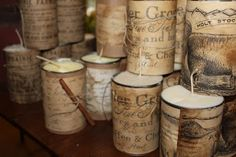 Farmhouse Candles -> Candles in tin cans wrapped with paper. I'd also add a cork circle to the bottom as a 'lifter'...to prevent the heat from the can that could do damage to your table.