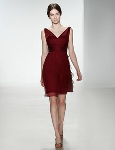 Ruby can be worn time and time again. For the holiday season, we'd throw on this Amsale dress with black tights and a fur capelet to wear to parties.