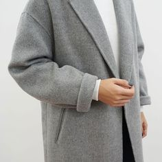 We love coats and we especially love grey wool-blend coats! Team it up with a white turtleneck jumper, a pair of comfy black trousers and white sneakers to create that minimalist look.