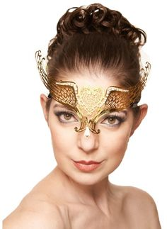 Adult size Gold Laser Cut Metal Mask with Heart and Clear Rhinestones   Made to be worn just over the eyes almost like a crown or circlet.   One size fits most.