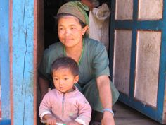 Sherpa mama and child, Khumbu Nepal. www.jeffreyrasley.com ~ they have elfish ears!