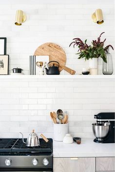 City Sage kitchen. Designed by Anne Sage and Studio McGee. Photo by Monica Wang. Rejuvenation hardware. Rejuvenation. White kitchen. White and brass. Fireclay tile. Fireclay tile kitchen. Brass edge pull. Brass hardware. Small drawer edge pull.