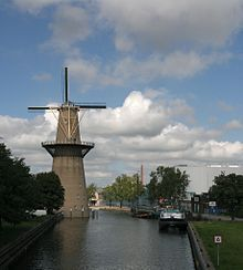 De Nolet is a wind turbine in Schiedam, The Netherlands which resembles a traditional Schiedam windmill. De Nolet has a tower height of 43 metres and a gross height of 55 metres including its rotor tips. It is 9 metres higher than De Noord which is the tallest windmill in the world. De Nolet was built in 2006 by the Nolet Distillery to power their brewing factory which produces the world famous Ketel One vodkas and gins.