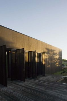 Sandhills Road House by Fearon Hay Architects.  Black stained #Plywood and #PerforatedMetal shutters.