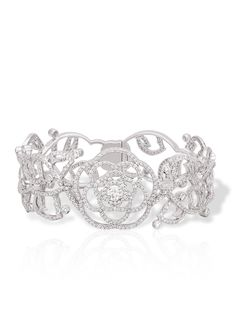 Chanel Camélia Cuff in 18K white gold and diamonds. Available at the Chanel Fine Jewelry Boutique at London Jewelers, Americana Manhasset. For more information, please call (516) 918-2700 to speak to a Chanel Fine Jewelry representative.