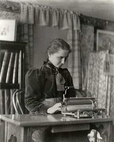 Helen Keller typing at a desk as a student at Radcliffe College, circa 1900