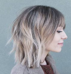 Blunt layers with bangs by Laci Nicole