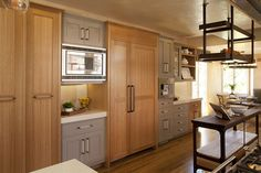 combination of painted and quarter sawn oak for cabinets + caesarstone countertops