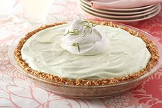 Crushed coconut bar cookies are the key to making a crust worthy of this crowd-pleasing Key Lime Cheesecake Pie.