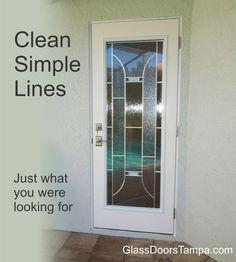 bathroom door to lanai has modern decorative glass door insert for privacy .