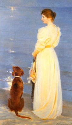 lady and dog by the lake