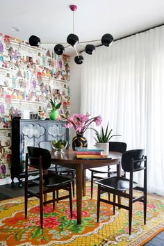 wouldn't you like a cup of coffee in my new dining room? Home styling by the talented Gili Ungar http://giliungar.co.il/  Wallpaper by Manuel Cnovas  http://www.manuelcanovas.com/   Rose kilim rug by Rozenkilim http://www.kilim-online.com/kilim-rugs.html  Dining table- danish vintage, Wood cabinet- british vintage, Light- private design Flower Vase- Jonathan Adler
