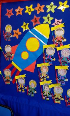 Outer Space Classroom Theme: Astronauts holding pencils with pupils' date of birth