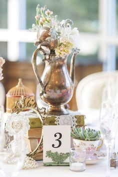 Vintage table scape one of a kind decor from Rent My Dust vintage rentals Romantic Garden Wedding, Silver teapot, succulant, pearls perfume bottles, lace, teacups tea party wedding
