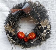 This has been sold but I could make another very similar one. This wreath has a touch of creepy, a dash of elegance and a splash of color to make it the perfect Halloween wreath. To achieve the wild and