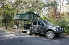 Lifted Frontier with cool bumper and bed rack with tent.