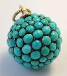Victorian gold ball charm pave set in turquoise.