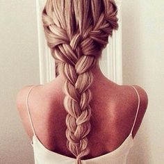 Beautiful simple braid. To make: french braid a section of your hair on either side. Once they reach the back, braid the rest down. This works better with thick hair.
