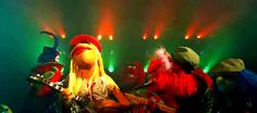 The Muppets are a group of puppet characters known for an absurdist, burlesque and self-referential style of variety-sketch comedy. Having been created in 1955 by Jim Henson, they are the namesake for the Disney media franchise that encompasses films, television series, music recordings, print publications, and other media associated with The Muppet Show characters.