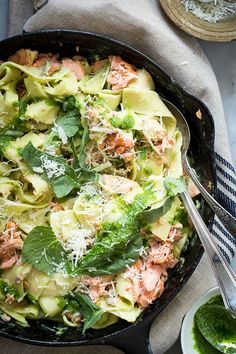 Amazing pappardelle pasta with flaked salmon and tossed in a creamy spinach and watercress cream sauce. Make this for a weeknight dinner, you'll love it!