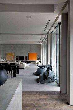 Casa de luxo e moderna com todos os ambientes integrados decorada com porcelanato de cimento queimado