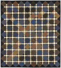 Second Hand Clothes in brown and blue. Kit includes pattern and fabric for the quilt top
