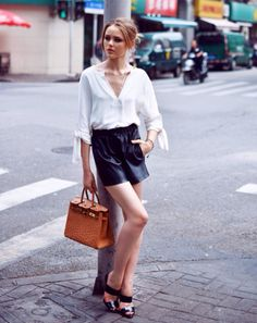 white blouse + black leather shorts