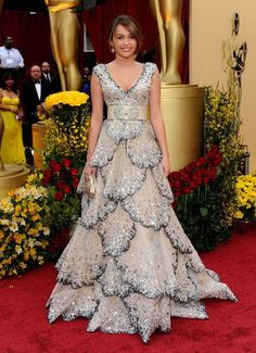 Miley Cyrus at the Oscars in 2009.  She's wearing a gown by Zuhair Murad.