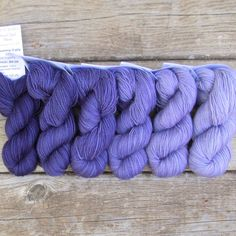 The Pleiades set includes the colors Dark Pleiades, Pleiades, Celaeno, Taygeta, Maia, and Electra; the color family ranges from violet-purple to lavender. Gradient Set Six skeins of our Yummy 2-Ply To