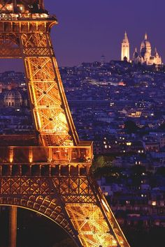 AMAZING PLACES - Paris by night, a beautiful view of the Tour Eiffel and the Basilique du Sacré-Coeur in Montmartre...