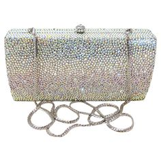 This Anthony David crystal clutch evening purse has a solid metal frame with a silver electro-plated finish. The metal body is fully covered with handset Aurora Borealis crystals. You can carry thi...