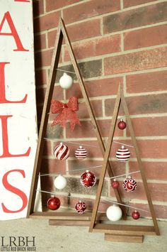 """Knock-off Crate & Barrel Ornament Trees - """"I love the Crate & Barrel style but not their prices. I fell in love with these ornament trees when I saw them and knew I had to DIY a pair of my own. So I busted out my tools and crafted up these in an afternoon."""":"""