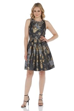 This stunning Limited Edition embellished jacquard dress is perfect for a special event. Featuring an all over floral jacquard, this fully lined dress is cut in a flattering skater skirt style with a heavily embellished neckline. Wear with your favourite heels and add a bold lipstick colour, keeping your jewellery minimal to complete your look. Dress length measures approximately 98cm to 102cm depending on size.