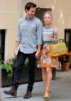 Floral romance: The shoes fit in perfectly with AnnaSophia's, seen here with co-star Chris Wood, bright floral outfit which included an oran...