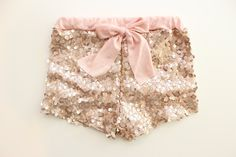 Choose your print and size from the drop down menu on the right. These run true to size. Most adorable shorts for kids!! Beautiful Blush Sequin fabric with a blush knit lining the inside and an adorable matching bow with an elastic waistband.These are the most adorable organic cotton bloomers! Home to the original metallic gold and gold glitter polka dots!