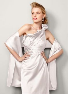"""The perfect statement for your gorgeous dress.  What better way to hit the high note than with this satin wrap.  Wrap measures 81"""" in length and 18"""" in width.  Imported. Dry Clean."""
