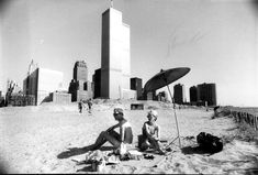 The ground excavated for the World Trade Center became Battery Park City. Bare landfill formed a beach in July 1983.