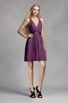 b280bf7107 This short chiffon dress features luminous touches of satin at the  waistline and crisscrossing back straps