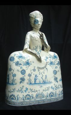 """""""Girl with the silver hands"""" by Claire Partington (Earthenware, Glaze, Enamel, Luster) This is based on a story published by the Brothers Grimm in which a father must cut his daughter's hands off to avoid her betrothal to the devil"""