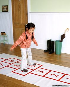 When the weather is cold and rainy, your child can still get a little physical activity with a homemade hopscotch mat. You can also keep it out year-round as part of their floor decor.