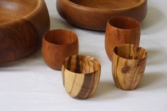 Beautiful cups made from Olive and Cherry wood on a lathe.