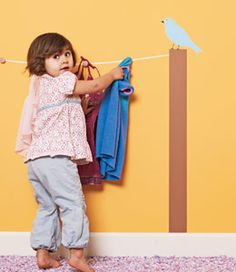 pick your toddler's outfit the night before, then hang it on a fun folk-art clothesline so she can dress herself in the am. would be cute in a mudroom to hang coats, totes, and book bags too!