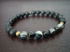 men's strength & protection mala bracelet - $24 #men #onyx #lavarock #bracelet #mensjewelry #5thelementyoga