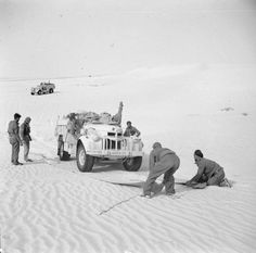 BRITISH ARMY NORTH AFRICA 1942 (E 12396)   Sand mats being used to help an LRDG Chevrolet 30cwt truck pass over soft sand, 25 May 1942.