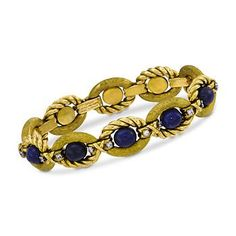 C. 1970. From Tiffany, this sensational 1.00 ct. t.w. diamond and lapis bead bracelet makes a breathtaking fashion statement! Intricate detailing and artistic texturing lead the eye in a serpentine pattern, graced at each station along the way with sparkling diamond rounds. Intense and mysterious lapis ovals secure the center of each glorious link, as if anchoring the eye in this masterful design. Foldover clasp closure. Textured and polished 18kt yellow gold bracelet.  <b>Exclusive…