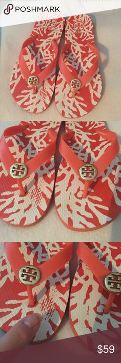 Tory Burch Flip Flops Tory Burch flip flops in a coral pattern. Size 7. Good condition with slight rub of pattern on foot beds as shown. Some wear to soles of shoes also. Orange straps with Gold medallions. Super fast shipping on all my items! Offers are welcome by using the blue offer! See lots more Tory Burch in my closet! Lilly too!!! No trades! Tory Burch Shoes Sandals